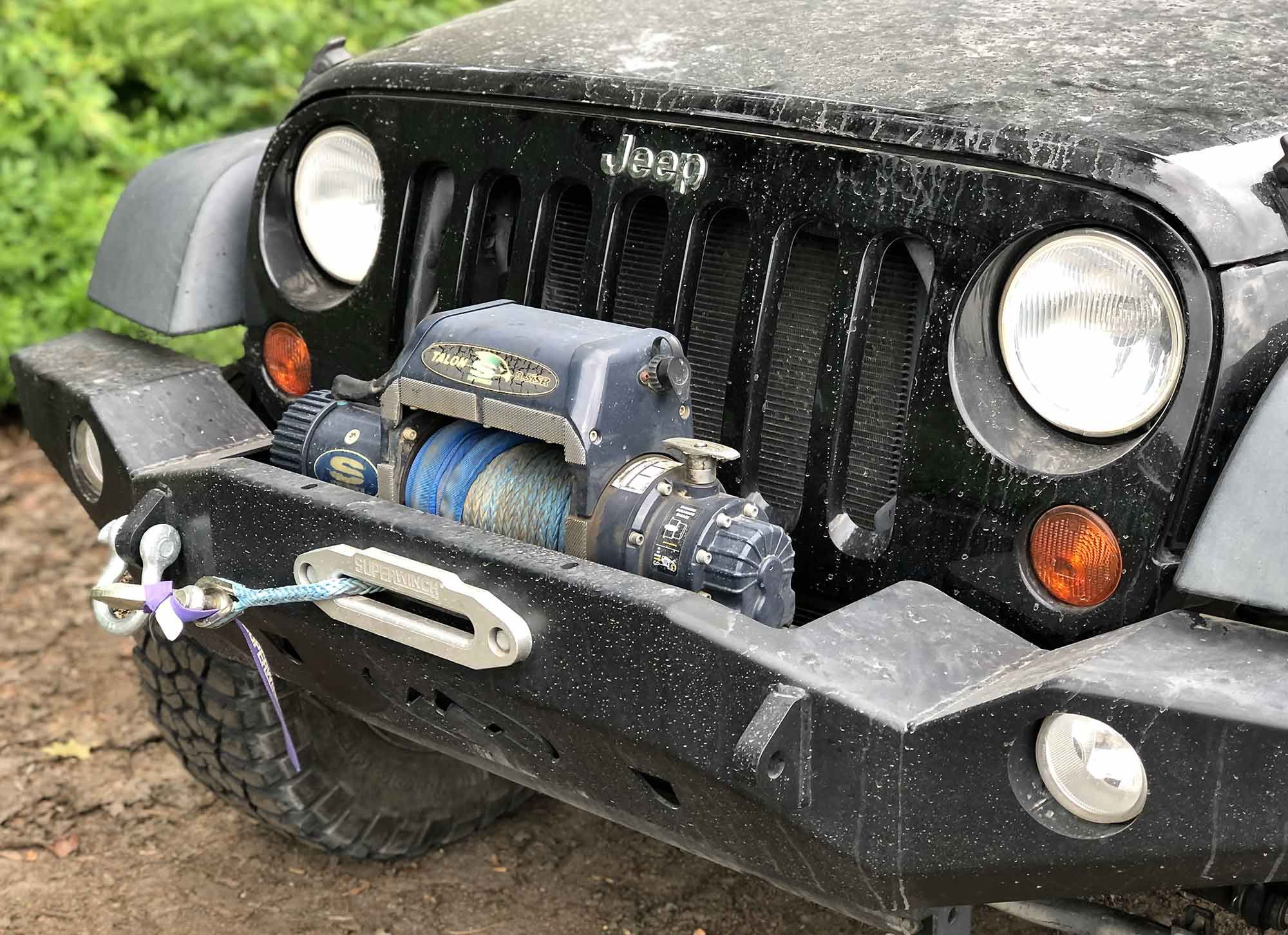 A winch and steel front bumper mean the Jeep's front end is kitted just like many side-by-sides.