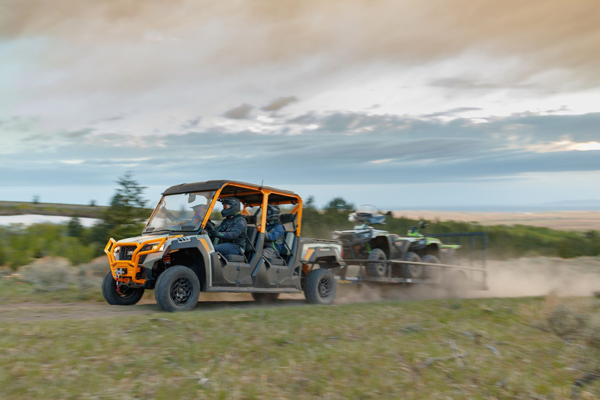 2022 Arctic Cat Prowler Pro Crew six-seater utility side-by-sides pulling a trailer.