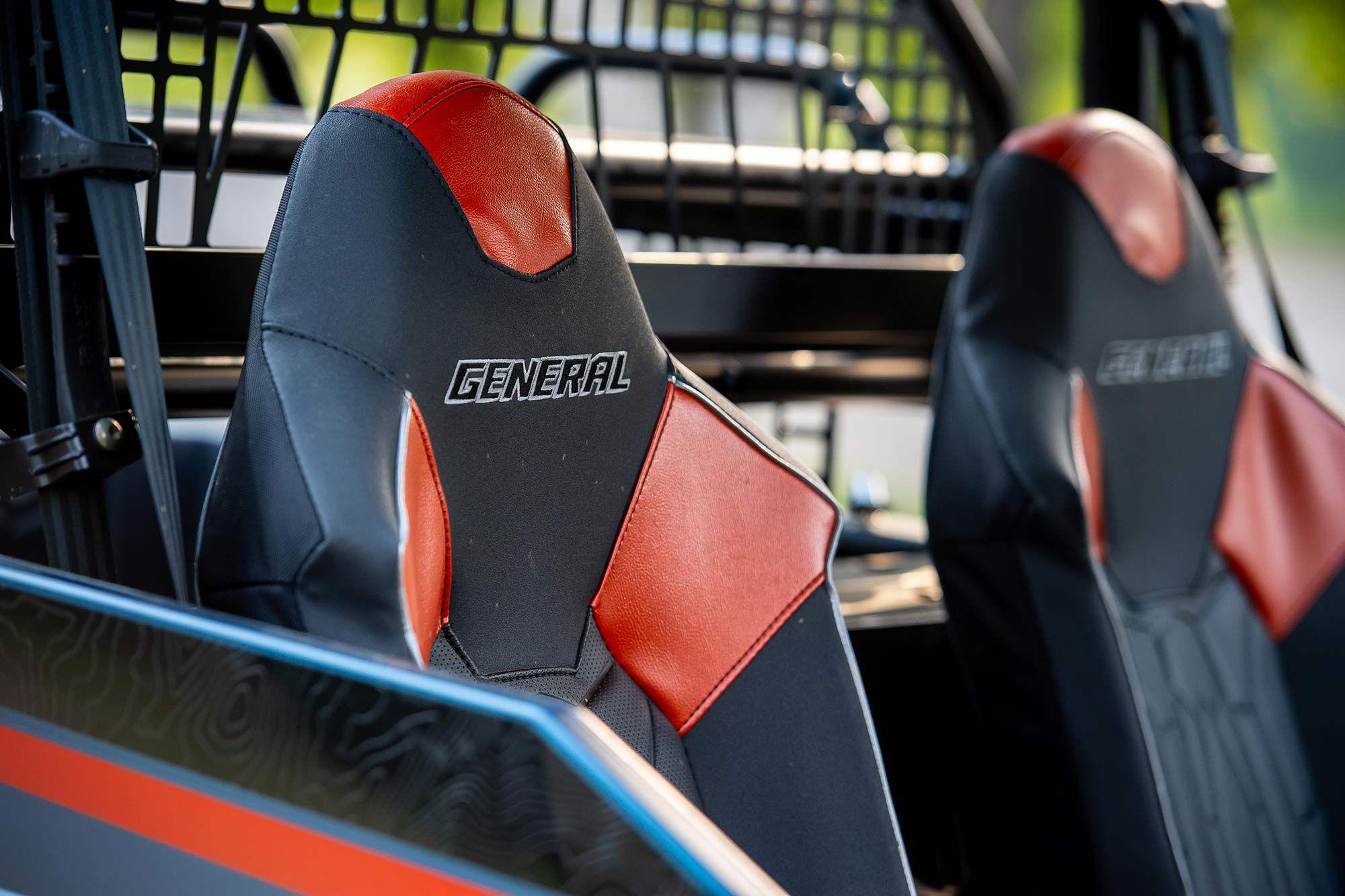 Premium two-tone bolstered seats keep passengers comfortable.