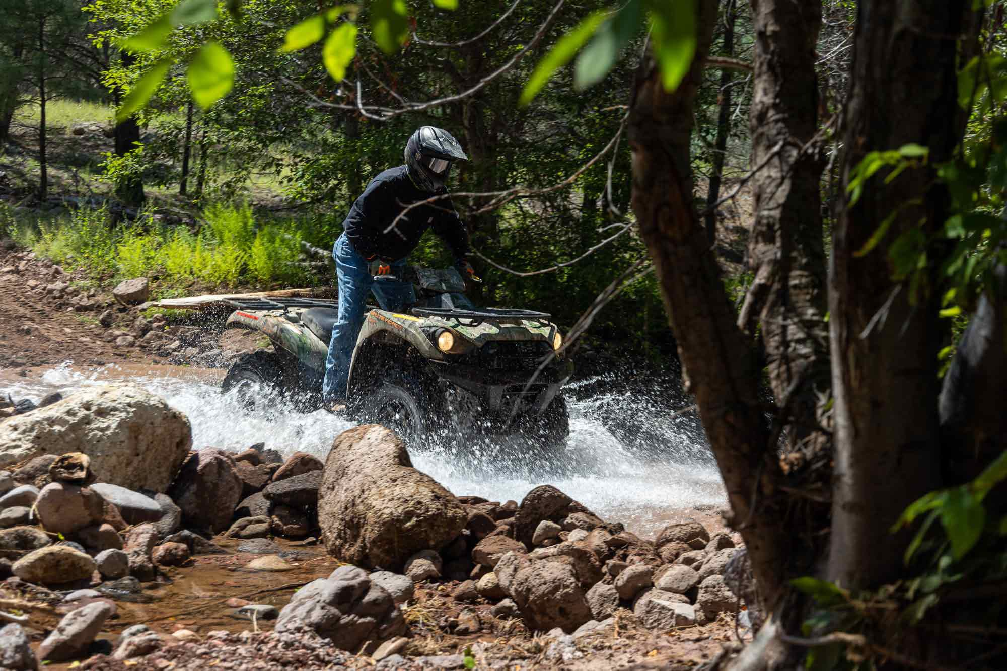 <i>ATV Rider</i> Executive Editor Jeff Henson handles a stream crossing on the 2021 Kawasaki Brute Force 750 he brought for our week in the wilderness.