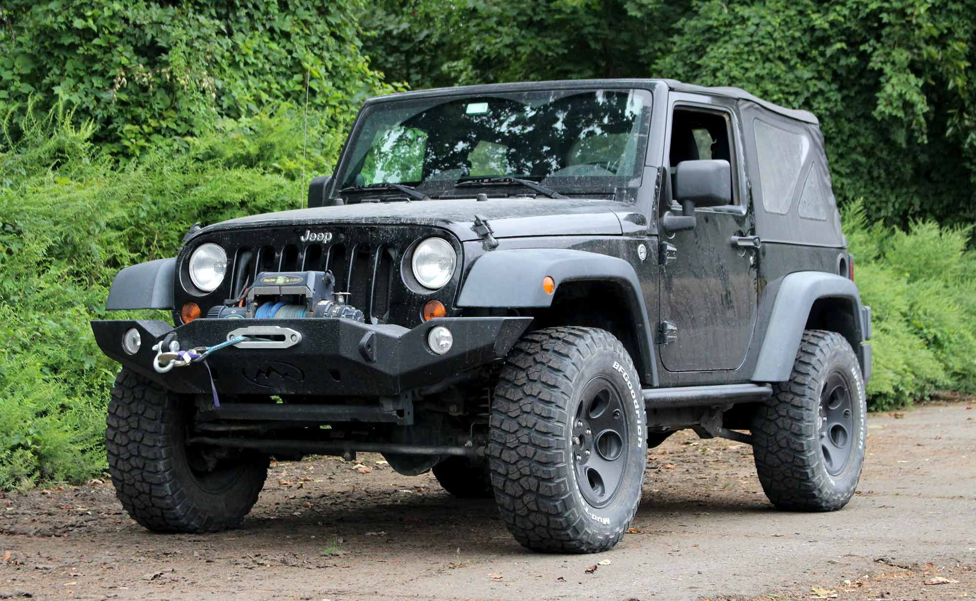 Our new-to-us 2012 Jeep Wrangler Sport will both tow and be compared to UTVs.